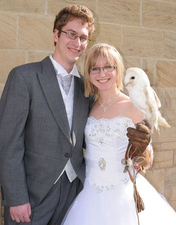 Bride and groom with their ring delivery barn owl